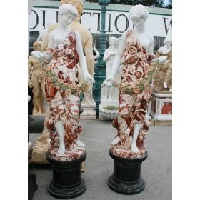 pareja de esculturas de mármol con peana
