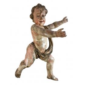 Escultura de niño con los brazos extendidos
