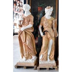 Pareja de esculturas estaciones realizadas en varios tipos de mármol