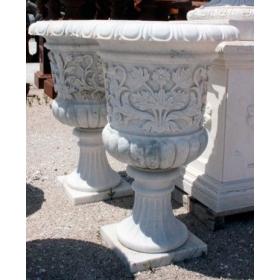 Pareja de mármol talladas a mano con detalles de flores