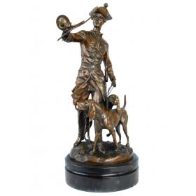 Cazador con perro de bronce con pena de mármol