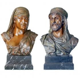 Pareja de bustos hombre y mujer de bronce con peana de mármol