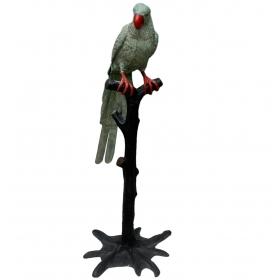 Loro sobre tronco realizado en bronce