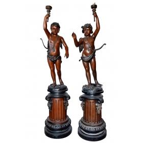 Pareja de lampareros angelitos realizados en bronce con peana