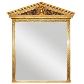 Espejo con marco dorado y rostro de mujer