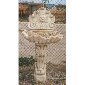Fuente mural cabeza de león de piedra recompuesta