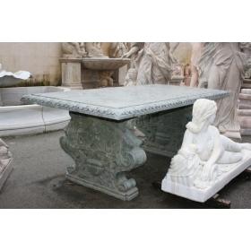 Mesa de mármol verde con pies tallados a mano