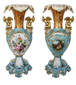 Pareja de jarrones antiguos realizados en porcelana