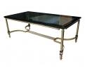 Mesa rectangular con tapa de cristal y pies dorados estilo vintage
