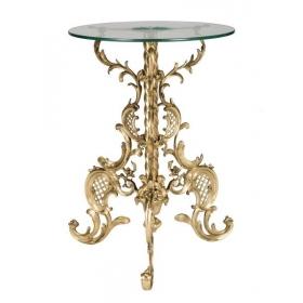 Mesa circular con tapa de cristal y pie de bronce dorado