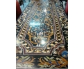 Tablero de mesa rectangular para doce comensales, con incrustaciones de piedras duras