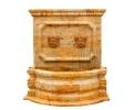 Fuente de pared con dos cabezas realizada en mármol