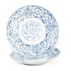 Par de platos en porcelana china para la exportación en azul y blanco. S. XIX.