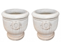 Pareja de maceteros realizados en mármol