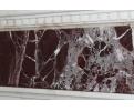 Chimenea realizada en mármol blanco y rojo levante. Adornada con copas y columnas.