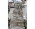 Buda de piedra sentado tallado a mano