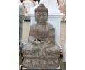 Escultura de piedra oriental con peana